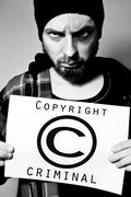 Stock Photo of copyright criminal