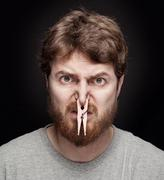 Bad smell concept - peg on male nose Stock Photos