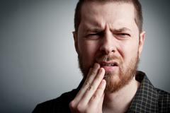 Toothache - man with teeth problems Stock Photos