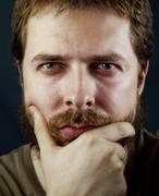 Face of one intelligent serious man Stock Photos