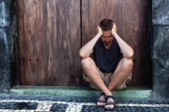 Depression - sad and poor man on the street Stock Photos