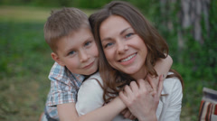Young attractive mother and son looking into the camera Stock Footage