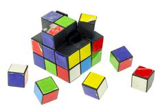 Broken rubiks cube puzzle Stock Photos