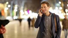 Smartphone man talking on smart phone at night Stock Footage