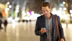 Smart phone man calling on mobile phone at night Stock Footage