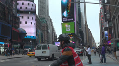 Times Square video display banner traffic car street taxi yellow NYC New York US Stock Footage