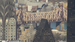 Aerial view Queensboro bridge Chrysler tower NYC New York Manhattan rooftop day  Stock Footage