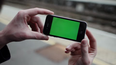 Green Screen iPhone 4 at Train Station.mp4 Stock Footage