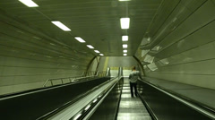 Istanbul, metro, man is going down with escalator, greeny scene Stock Footage