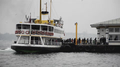 Passengers get off and on from berthed ferry, time lapse, Istanbul  Stock Footage