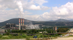 Time lapse country highway and power plant Stock Footage