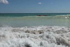 Sea foam ocean breaking whitecap waves washing beach sand Stock Footage