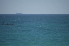 Transportation ship sailing on horizon over water Stock Footage