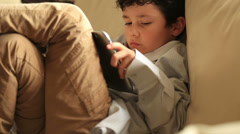 Little boy relaxation with digital tablet Stock Footage