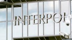 Stock Video Footage of Interpol logo on headquarter building