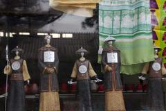 Imperial guard figurine souvenirs being showcased in a window - stock photo
