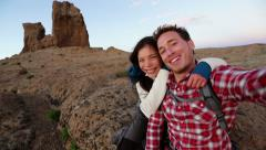Selfie - Happy couple taking self portrait hiking - stock footage