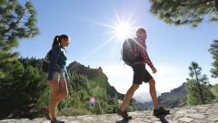 Hiking couple walking on trail - stock footage