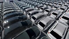 Many new cars different colors parked and distributed in rows. Stock Footage