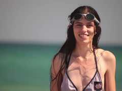 Brunette young adult woman wearing swim goggles portrait. Stock Footage
