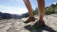 Hiking shoes walking close up during hike - stock footage