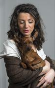 Stock Photo of woman is holding her dog