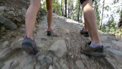 Stock Video Footage of Hiking people - shoes close up and tilt