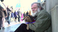 Elderly man and dog sitting on streets of Prague Stock Footage