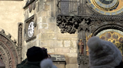 People looking at the Prague astronomical clock Stock Footage