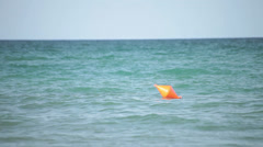 Red buoy floating on ocean waves Stock Footage
