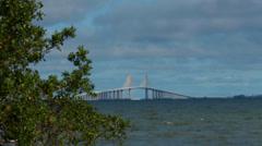 Sunshine Skyway Bridge blurred in background Stock Footage
