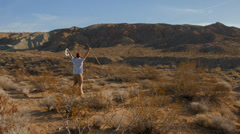 Triumphant in desert Stock Footage