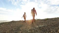 People hiking - hiker couple at sunset Stock Footage