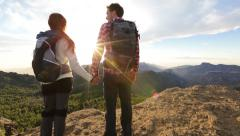 Couple holding hands hiking outdoors - stock footage