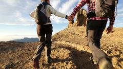 Holding hands - couple hiking Stock Footage