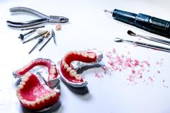 dental laboratory. work tool for make a denture in technician workplace. - stock photo