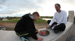Time lapse of father and son playing checkers Stock Footage