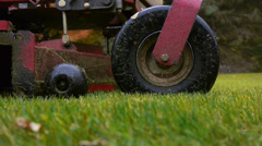 Stock Video Footage of Stand-On Riding Lawn Mower Drives Away on a Rainy Day