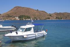 fishing boat in the harbor of the greek islands - stock photo