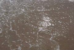 Ocean sea whitecap waves washing beach shore sand Stock Footage
