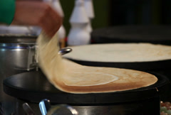 Cooking checking pancake onto griddle Stock Footage
