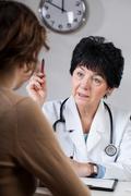 Doctor giving advice Stock Photos