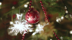 Christmas tree with color balls and burning sparkler Stock Footage