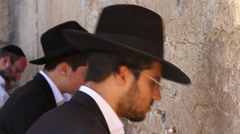 Closeup of orthodox jewish men at the Western Wall Stock Footage