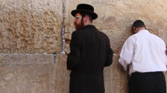 Hasidic Jews praying at the Western Wall Stock Footage