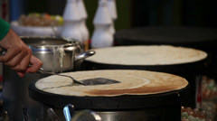 Cooking spatula pressing checking pancake onto griddle Stock Footage
