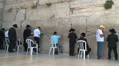 People in Jerusalem visit and pray at the Kotel Stock Footage
