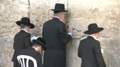 People stand and pray at the Kotel Stock Footage