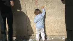 Cute jewish kid at the western wall Stock Footage