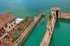 scaliger castle surrounding wall on lake garda. - stock photo
